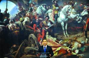 PM Viktor Orban in front of a work he commissioned at the Hungarian National Gallery.
